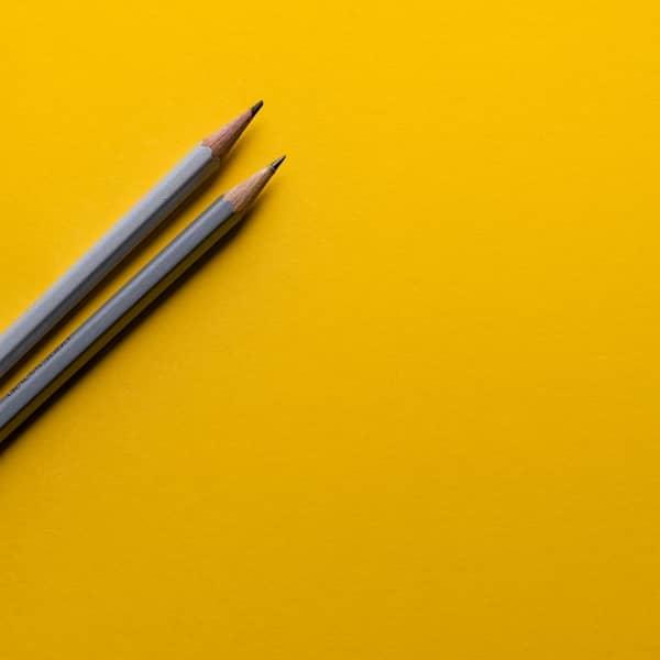 Lav rente - billede med to blyanter
